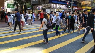 Diverse peple crossing the city street on zebra