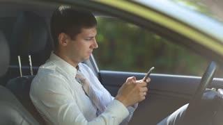Entrepreneur surfing net on phone in car