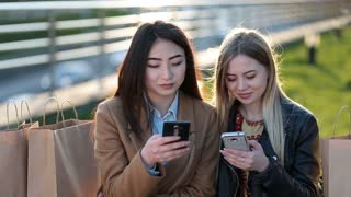 Euphoric friends watching videos on smartphone