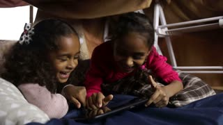 Excited girls watching funny video on tablet