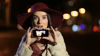 Girl showing smartphone with offer on screen
