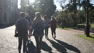 Group of college students walking outdoors