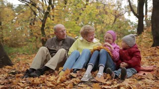 Happy family spending leisure in autumn park