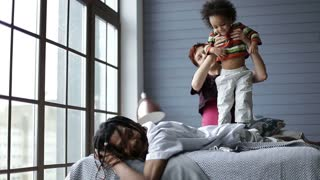 Happy interracial family spending leisure at home