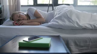 Happy woman stretching in bed after wake up