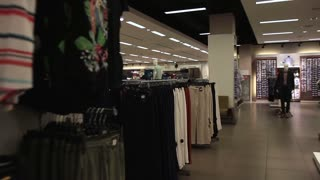Interior of fashionable shop with different clothes