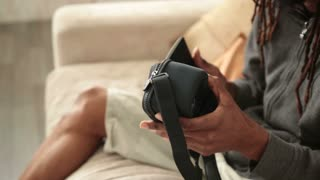 Male hands inserting mobile phone into VR glasses