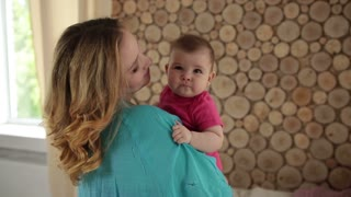 Mother and sweet baby girl dancing at home