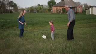 Multi generation family playing soccer together