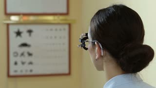 Optometrist doctor examining eyesight of patient