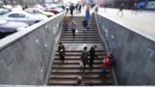 People walking on stairs to underground crossing