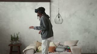Playful hipster man wearing virtual reality device
