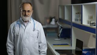 Portrait of friendly senior male doctor smiling