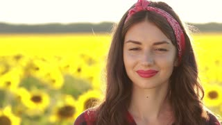 Portrait of smiling attractive woman in nature