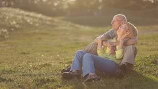 Senior couple in love enjoying togetherness outdoor