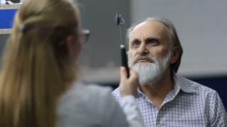 Senior man examined by female neurologist in clinic