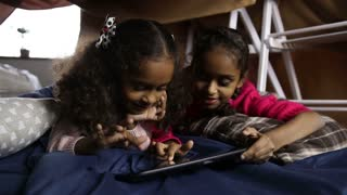 Smiling african american girls using tablet pc