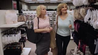 Smiling senior women shopping at clothing store