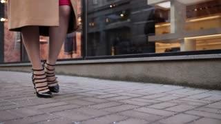 Stylish woman in high heels walking