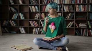 Thoughtful young woman enjoying reading a book