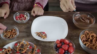 Three generation family making chocolate cookies