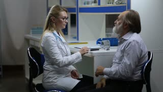Woman doctor inspecting patient's nervous system