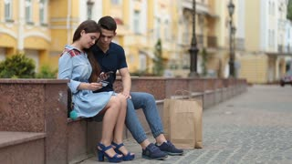 Young couple shopping online using mobile phone