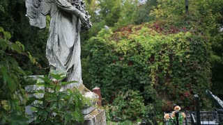 Vintage statue of winged angel at the graveyard