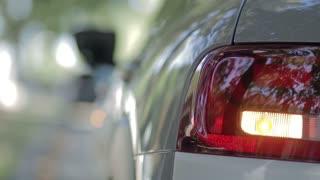 Woman opening car gas tank cap