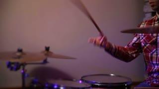 Young hipster drummer juggling drumsticks