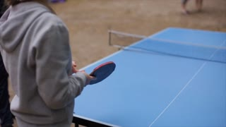 People playing table tennis outdoors. Close-up. Slow motion