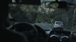 Barcelona, Spain - April 28, 2018: A car making a sharp turn on the mountain road