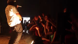 Belarus, Bobruisk, 20. 10. 2016 A rap rock concert. Black male rapper. Cheering crowd. White crowd. Professional smoke. Flashing lights.