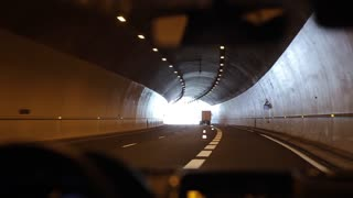 Driving slowly through a tunnel. Light at the end of the tunnel