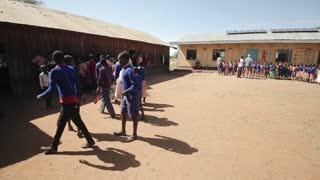 KENYA, KISUMU - MAY 20, 2017: Big group of African children in uniform standing outside, near the school.
