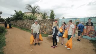 KISUMU,KENYA - MAY 15, 2018: Group of Caucasian people with packages. The volunteers traveled to Africa to help the poor families.