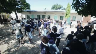 KISUMU,KENYA - MAY 15, 2018: Group of people dancing in Africa. Men, women and kids having fun after lessons.