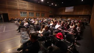 rest, Belarus - MAY 9, 2018: Rear view of the audience at the business conference. Big screen. Presentation. ;rear view of the audience at the business conference.