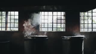 Smoking pots in the kitchen near the window. Food is cooked in big boilers with cap.