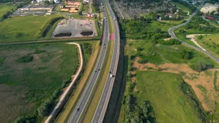 Aerial View Of A Freeway. Descending Shot Cars driving by the road. Traffic on the highway. 4K footage from drone.