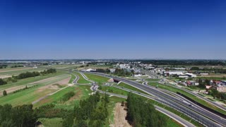 Complex road junction. Sunny day, sunset. Modern Europe. Aerial high altitude drone flight.