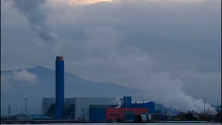 Turin, Gerbido, Piedmont Italy March 17 2018. The waste-to-energy plant of the company TRM-GRUPPO IREN. The cold and overcast weather enhance the fumes and the steam emitted from the system. Time lapse at dusk.