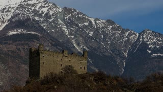 Ussel fraction of Chatillon, Valle d'Aosta, Italy 11 February 2018. Three-quarters rise to the left of the medieval castle of Ussel. Timelaps of 20 minutes in 10 seconds. The clouds flow over mountain