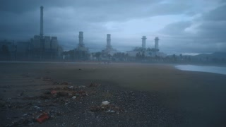 Dramatical view on empty industrial beach at strong storm, fog, rain, wind, big waves and gray clouds on sky