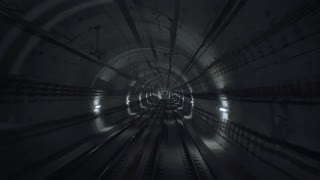 Pov view of shaking subway train on rails using his breaking system hardly before arriving on very deep empty cold lightened underground station. Video for computer or vr gameplay illustration