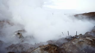 Thick fog smoke goes from underground from geyser holes