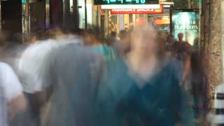 4K Anonymous Commuter  crowd walking on a street. Time Lapse slow shutter blurred motion