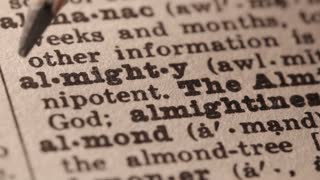 Almighty - terms referring to the Judeo-Christian God. Macro close up of Pencil underlining the word Almighty in fake Dictionary