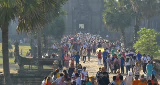 ANGKOR WAT, CAMBODIA - NOV 2015: Large crowds of tourists entering temple complex