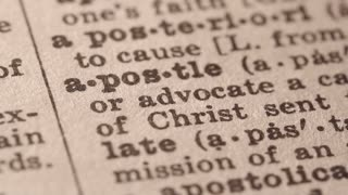 Apostle - any important early teacher of Christianity or a Christian missionary to a people. Macro close up of Pencil underlining the word Apostle in fake Dictionary definition of the word, paper texture visible.